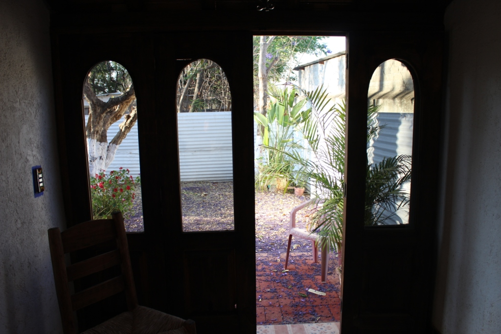 Doors in Bedroom Leading to Back Courtyard Area
