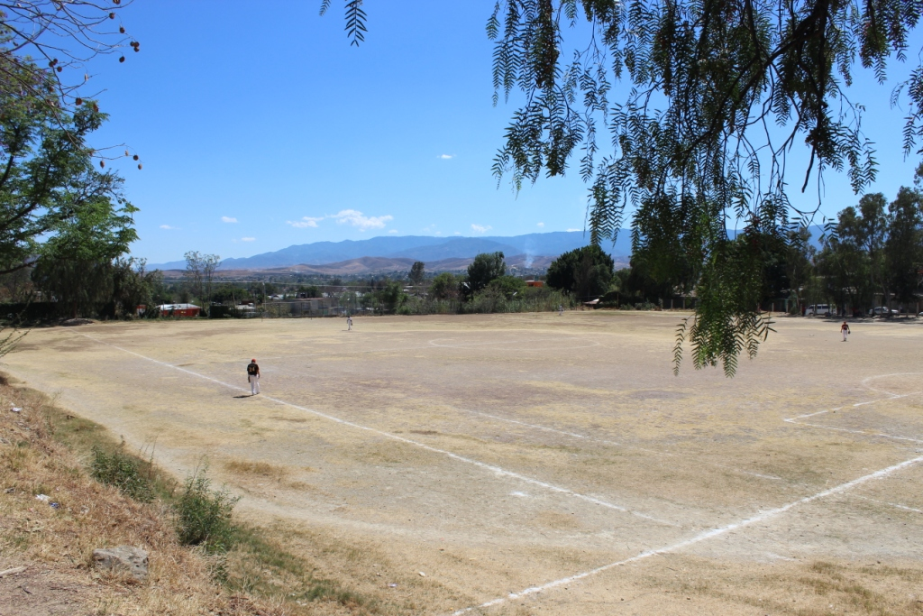 The baseball/soccer field during a Sunday game.