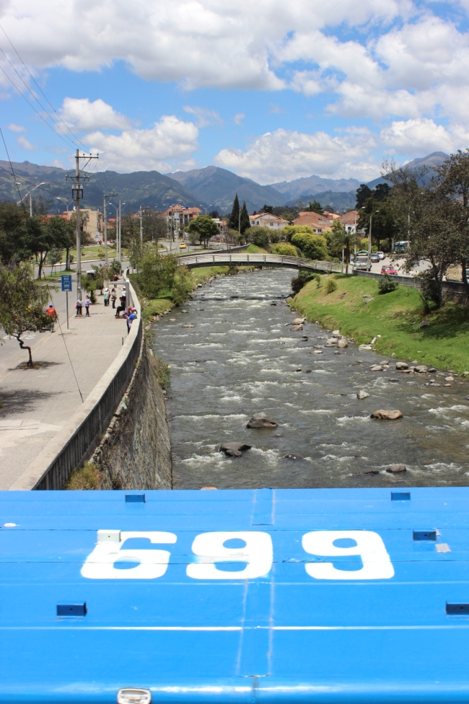 Passing a Bus While Crossing One of Cuenca's Four Rivers