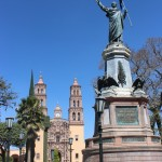 Statue of Miguel Hidalgo in the Plaza del Grande Hidalgo with the Parish of our Lady of Dolores in the background.